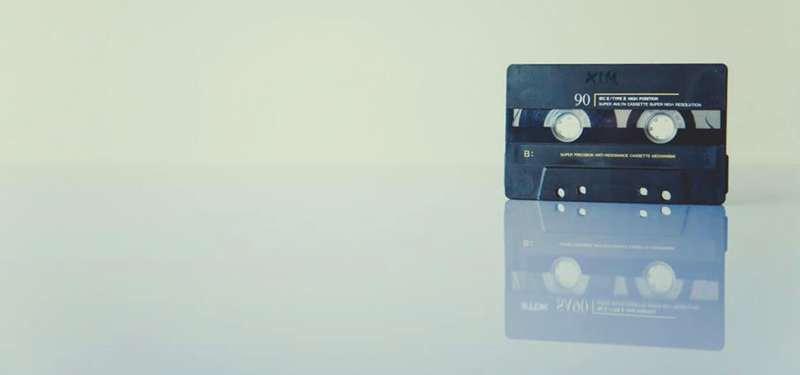 A cassette tape on a white background and reflective white floor